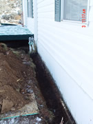 Allstate Animal Control skunk barrier being installed around a crawlspace