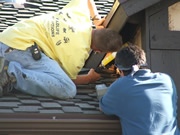 Allstate Animal Control techs sealing roof gaps